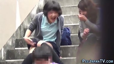 Analysis: Two asian girl pee on man