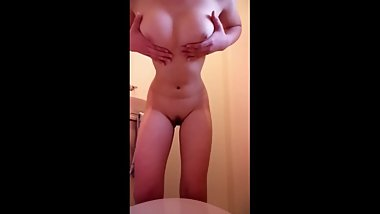 Asian Teen starts to slowly undress herself then moves to fingering herself