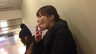 Smoking Fetish - Beautiful candid japanese chain smoker (too cute)