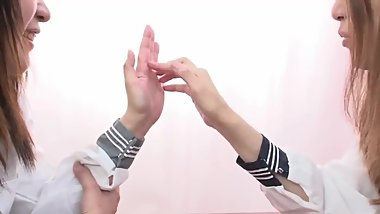 Japanese schoolgirls playing with each others' hands