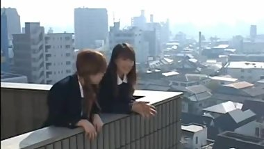 2 Lesbian Japanese student are kissing outside school