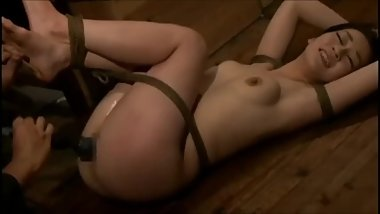 Bound asian whore gets whipped, oiled and vibrator fucked
