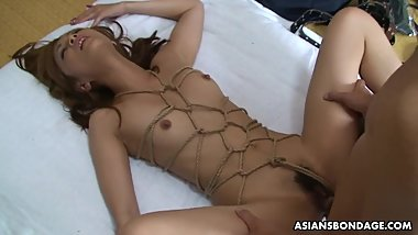 Gorgeous Asian wife is roped and roughly plowed from behind