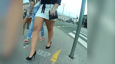 Spycam brunette MILF in miniskirt clothed like a bitch expose her huge ass
